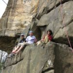 The kids hanging out on a ledge in the New River Gorge on our kids climbing trip in 2011.