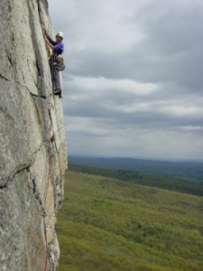 Cliffmama climbing the very exposed top pitch of CCK (Cascading Crystal Kaleidoscope) - Trapps, Gunks