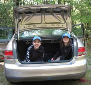 My kids in the truck of the car, smiling and having fun.