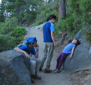 My big kids trying to stop our friend's 4 year old tired kid from melting down while hiking.