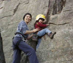 Cliffmama helping her kid climbing at the Gunks in 2001.