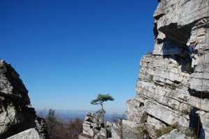 Deep blue sky in the background as Cliffmama climbs on Bonticou Crag at the Gunks