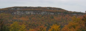 View of the Lost City band of cliffs surrounded by autumn leaves at the Gunks