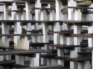 Many stacked picnic tables creating fascinating geometric patterns.