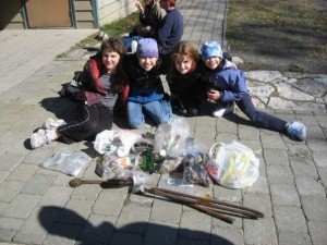 4 young climbing kids with bags of trash that they picked up at an Adopt-A-Crag event at Minnewaska in 2006.