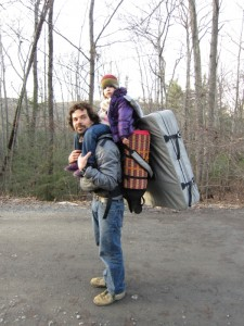 Climbing Dad, Chris, carrying gear, bouldering pad, kid supplies and his daughter on his back.