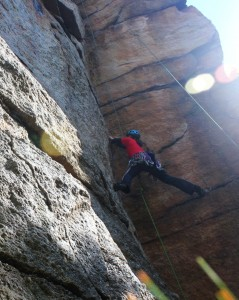 My daughter doing a mock lead of Golden Dream at Peter's Kill climbing area, Lake Minnewaska, The Gunks. 2012