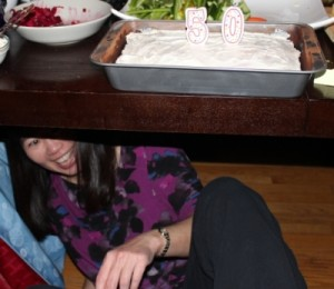 Cliffmama under the table after posing with her 50th birthday cake.