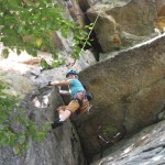 My daughter smiling as she rock climbs Double Chin at the Gunks, NY.