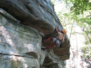 Sudha at the crux start of Double Clutch, 5.9+ rock climb at the Gunks.