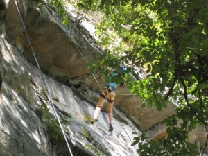 y daughter under the second roof on Something Scary, 5.10 rock climb at the Gunks.