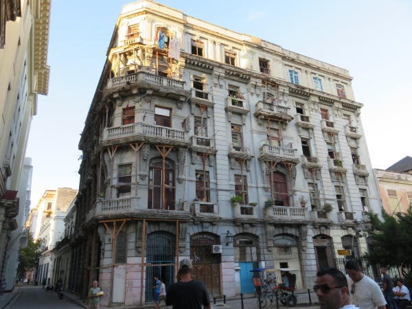 Beautiful old building in Havana, Cuba, balconies held up with stilts.