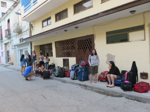 Group waiting for a bus on a street in Havana.