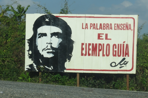 "Sign in Cuba with Che, translated: ""Words teach, but examples lead"""