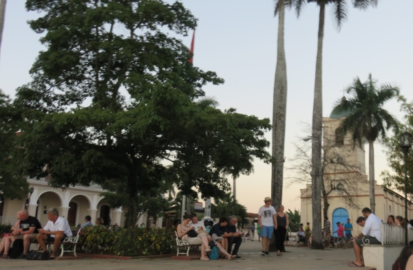 People on their smart phones in Viñales Town Square, Cuba.