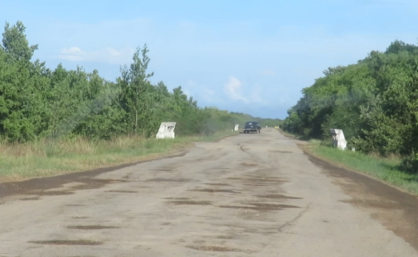 Potholes in road enroute to Cayo Jutia in Cuba.