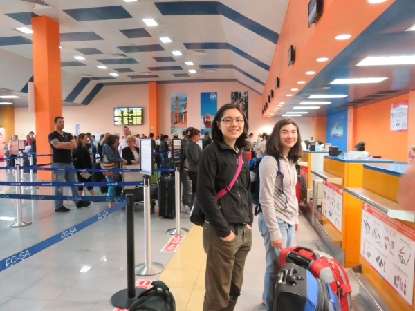 My kids, checking in at the airport in Cuba.